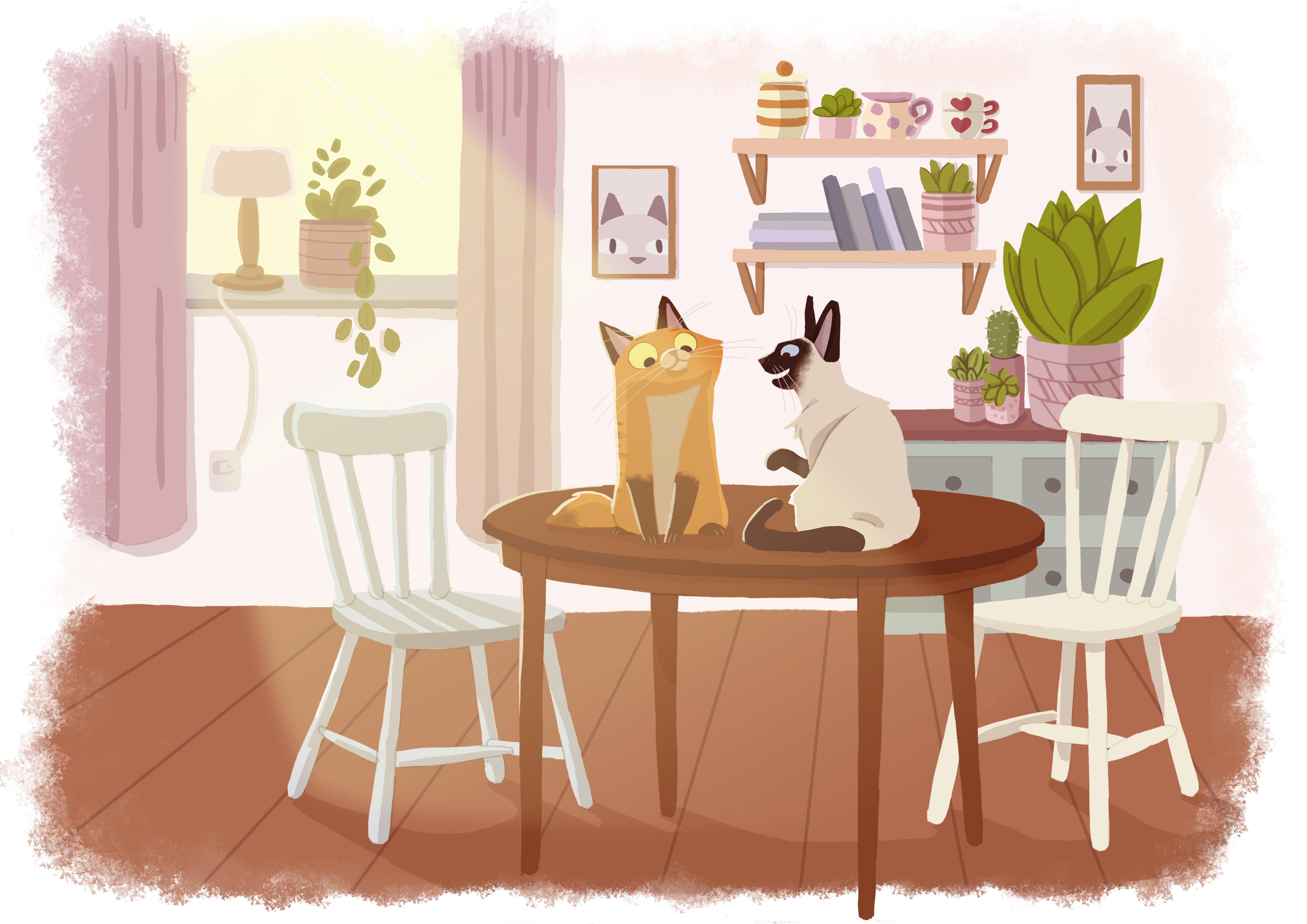 et bord Der sad to katte på et bord et bord